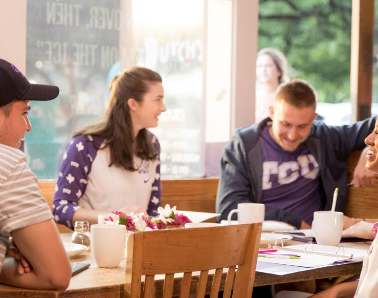 TCU students eating at Dutch's burgers near campus