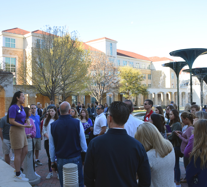 A TCU student leads a campus tour
