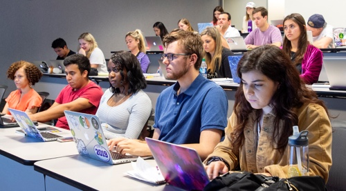 Students in a lecture using laptop computers